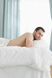 Portrait of a calm man lying on his belly Royalty Free Stock Photos