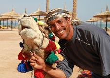 Portrait of camel and beduin Royalty Free Stock Photo