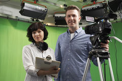 Portrait Of Cameraman And Floor Manager In Television Studio Stock Image