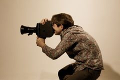 Portrait of cameraman with old movie camera Stock Images