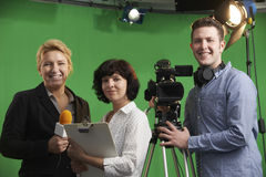 Portrait Of Cameraman With Presenter And Floor Manager In Televi. Portrait Of Cameraman With Presenter And Floor Manager In TV Studio stock photos