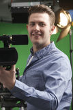 Portrait Of Cameraman Working In Television Studio Stock Images