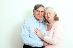 Portrait of candid senior couple enjoying their retirement. Affectionate elderly couple with beautiful beaming friendly smiles pos. Ing together in  close Stock Photo