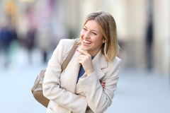 Candid woman laughing on the street. Portrait of a candid woman laughing alone on the street in winter Stock Photography