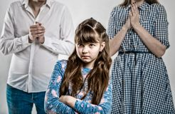 Portrait of a capricious spoiled child. Harmful girl. Photo on a gray background Royalty Free Stock Photo