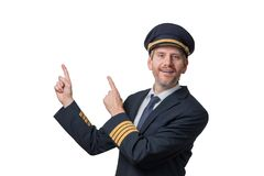 Captain in pilot uniform with 4 golden stripes points in the air. Portrait of a Captain in pilot uniform with 4 golden stripes points in the air isolated on Stock Photography