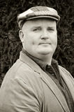 Portrait capture of a male with jacket and hat Royalty Free Stock Photography