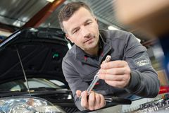 Portrait car engineer in garage Stock Images