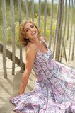 Portrait of a carefree older woman laughing outdoors Stock Photography