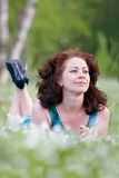 Portrait of the carefree woman. Portrait of the woman in park in a grass Royalty Free Stock Photos