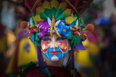Portrait in Carnival. Badajoz, Spain - March 2, 2019: Performers with costumes inspired in fantasy take part in the Carnival parade of comparsas at Badajoz City royalty free stock images