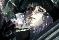 Masked woman in Venice carnival. Portrait of a carnival masked woman with gloves in color image Royalty Free Stock Photo