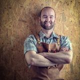 Portrait of carpenter. Portrait of caucasian smiling carpenter with apron stock image