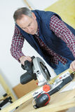 Portrait carpenter cutting wood using table saw Royalty Free Stock Photography