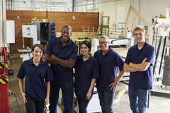 Portrait Of Carpenters In Busy Woodworking Factory Stock Photography
