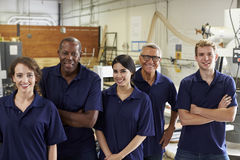 Portrait Of Carpenters In Busy Woodworking Factory Royalty Free Stock Images