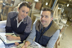 Portrait of carpenters in workshop royalty free stock photography