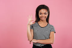 Portrait of a casual afro american woman showing ok gesture Stock Image