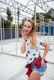 Portrait of a casual attractive blonde woman outdoors Stock Image