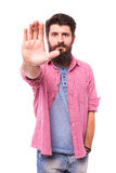 Portrait of a casual bearded hipster man showing stop sign Stock Photo
