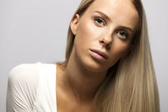 Portrait of a casual blonde woman in white top Royalty Free Stock Image