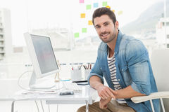 Portrait of a casual businessman posing and smiling Stock Image