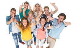 Portrait of casual cheerful people gesturing thumbs up Royalty Free Stock Images