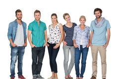 Portrait of casual happy people with hands in pockets Royalty Free Stock Images