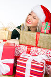Portrait of casual happy woman holding a lot of gifts Royalty Free Stock Photography