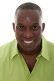 Portrait Of A Casual Man. Portrait of a handsome African American man in a bright green shirt and smiling looking directly into the camera Stock Photo