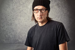 Portrait of Casual Man with Black Cap and glasses Stock Photos