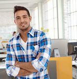 Portrait of casual man at office smiling Royalty Free Stock Photography