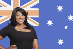 Portrait of casual mixed race woman against Australian flag Stock Images