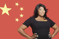 Portrait of casual mixed race woman against Chinese flag Royalty Free Stock Image