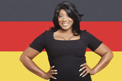 Portrait of casual mixed race woman against German flag Royalty Free Stock Photography