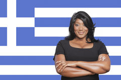 Portrait of casual mixed race woman against Greek flag Royalty Free Stock Photos