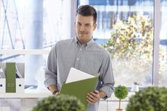 Portrait of casual office worker with folder Royalty Free Stock Photography