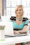 Portrait of casual secretary with laptop computer Stock Image