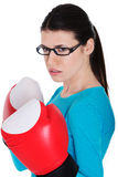 Portrait of a casual woman with boxing gloves. Stock Images