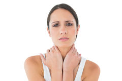 Portrait of a casual woman suffering from neck ache Stock Images