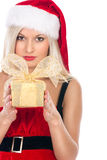 Portrait of a casual woman in a suit santa girl holding a gift Stock Photography
