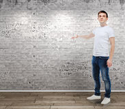 Portrait of casual young attractive man. Standing in front of a vintage wall Stock Images