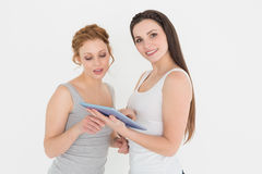 Portrait of casual young female friends with digital tablet Stock Photography