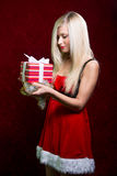 Portrait of casual young happy blonde hold striped gift box Royalty Free Stock Photography