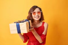 Portrait of casual young happy smiling woman hold gift box
