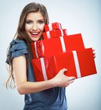 Portrait of young happy smiling woman hold red gift box. Isolat. Portrait of casual young happy smiling woman hold red gift box. Isolated studio background Royalty Free Stock Photo