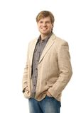 Portrait of casual young man. Portrait of happy casual young man standing with hands in pocket. isolated on white Stock Photography