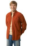 Portrait of casual young man. In jeans and orange shirt smiling, isolated on white Royalty Free Stock Photos