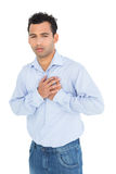 Portrait of a casual young man with chest pain Stock Photography