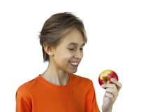 Portrait casual young man eating apple. Against a white wall Stock Image